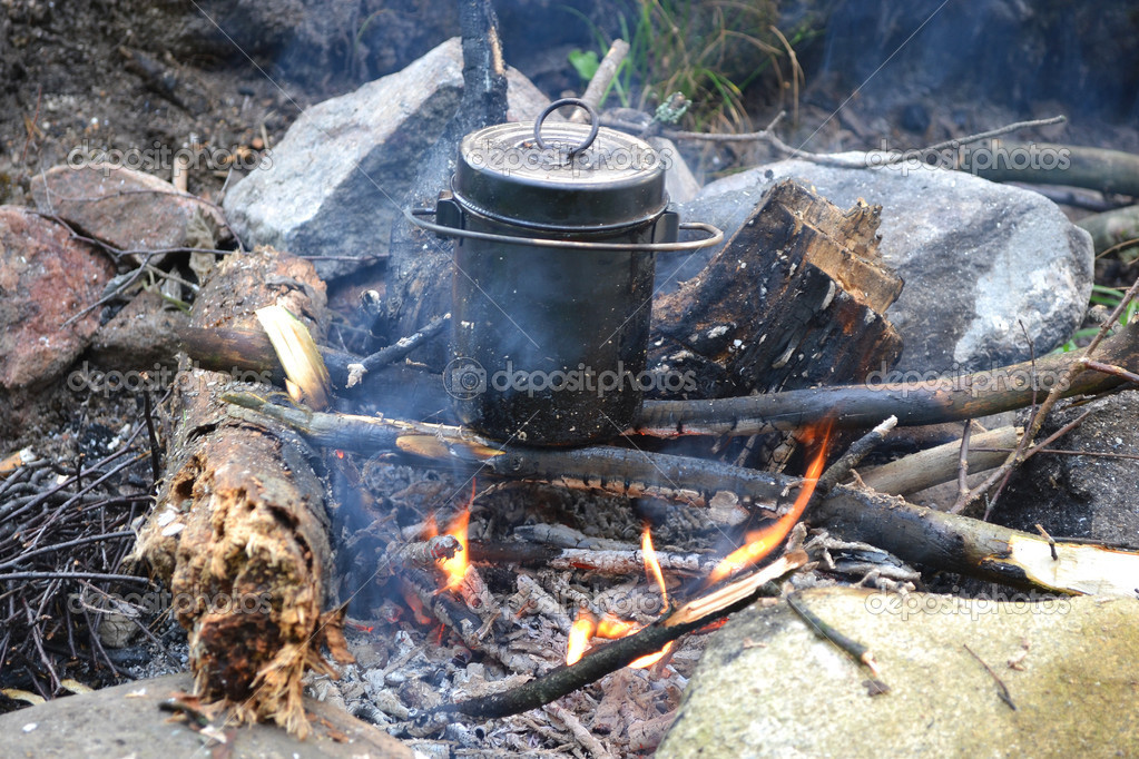 The image of a fire in the woods on which is brewed pot — Stock Photo #11648958