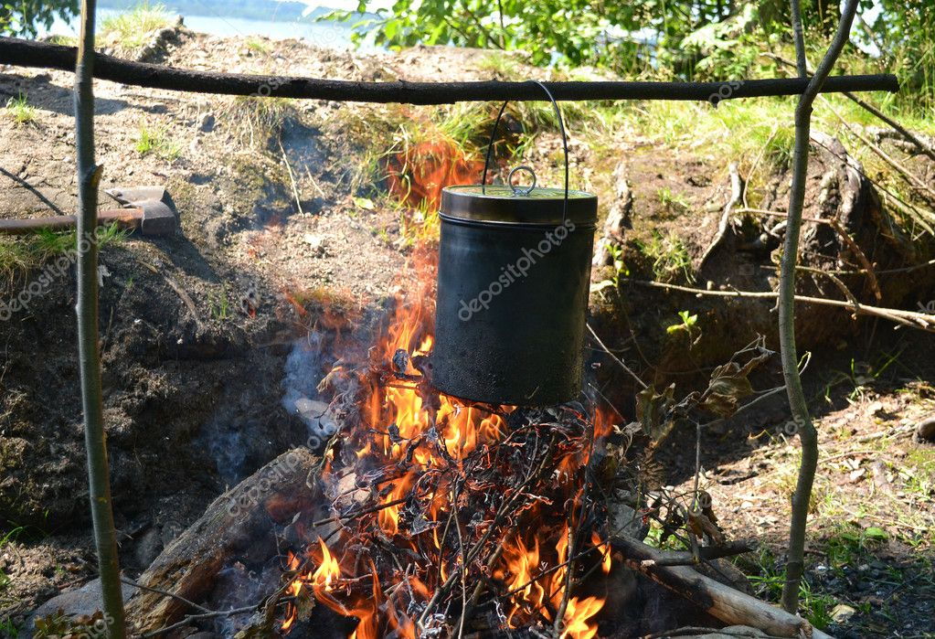 The image of a fire in the woods on which is brewed pot — Stock Photo #11649053