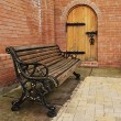Bench opposite door — Stock Photo #11373471