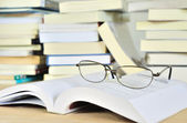 Glasses put on the book — Stock Photo