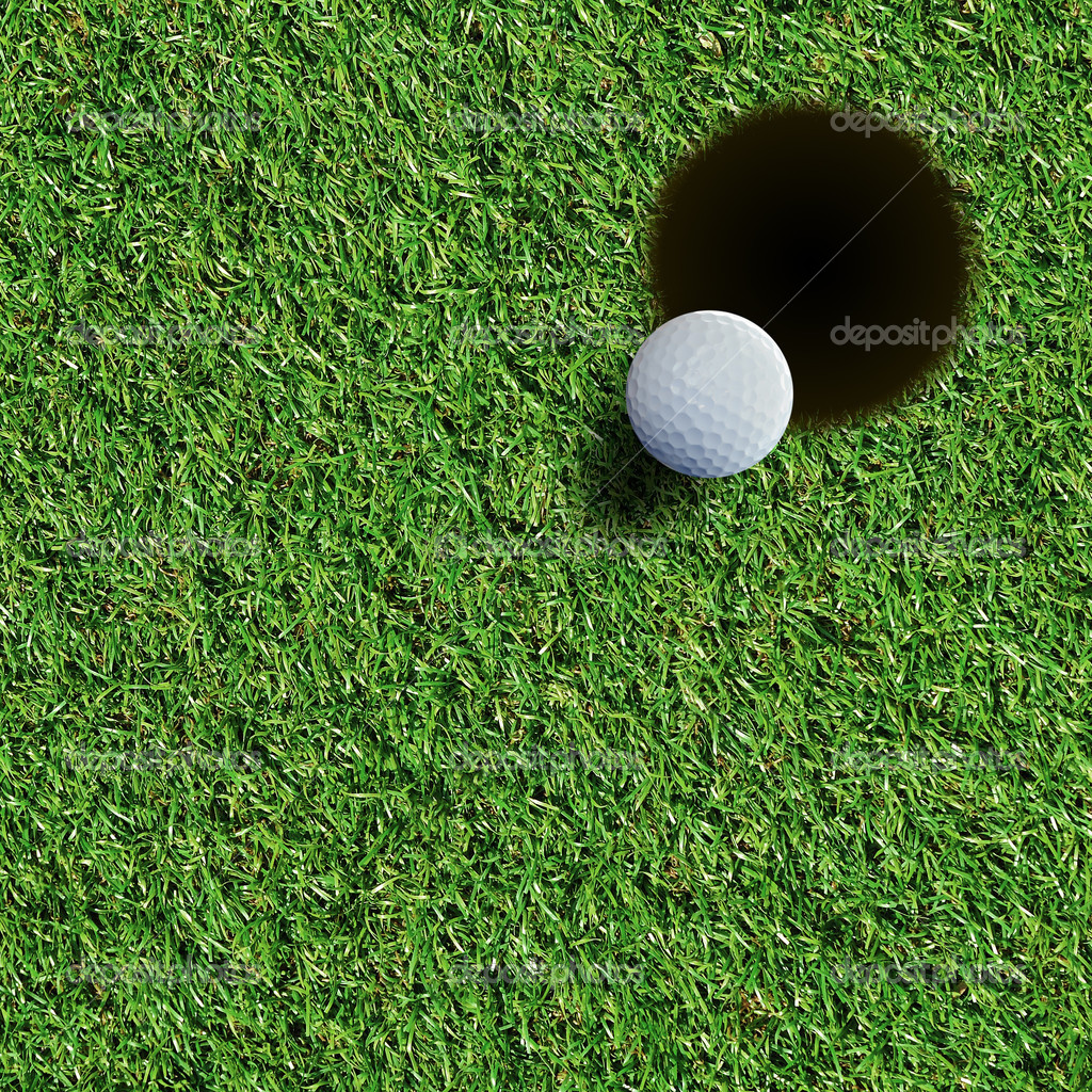 Golf ball on green grass — Stock Photo #12069574