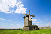 Wooden windmill on the green field — Stock Photo