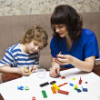 Stock Photo: Mother and sun modelling with plasticine