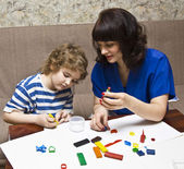 Mother and sun modelling with plasticine — Foto Stock