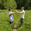 Young man and woman on a meadow — Stock Photo