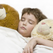 Sleeping boy with two bears — Stock Photo