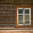 Vintage looking window of an old wooden house — Stock Photo