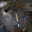 Flyfishing rod and a small stream. — Stock Photo