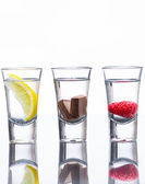 Flavoured vodka shots — Stock Photo