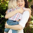 Royalty-Free Stock Photo: Mother happy hugging her child