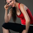 Smiling woman having a rest from exercise — Stock Photo