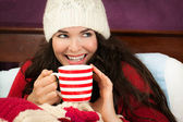 Beautiful woman having hot drink — Stock Photo