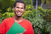 Uśmiechający się młody student z azji południowo-wschodniej — Zdjęcie stockowe