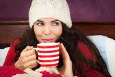 Beautiful woman having hot drink — Stock Photo