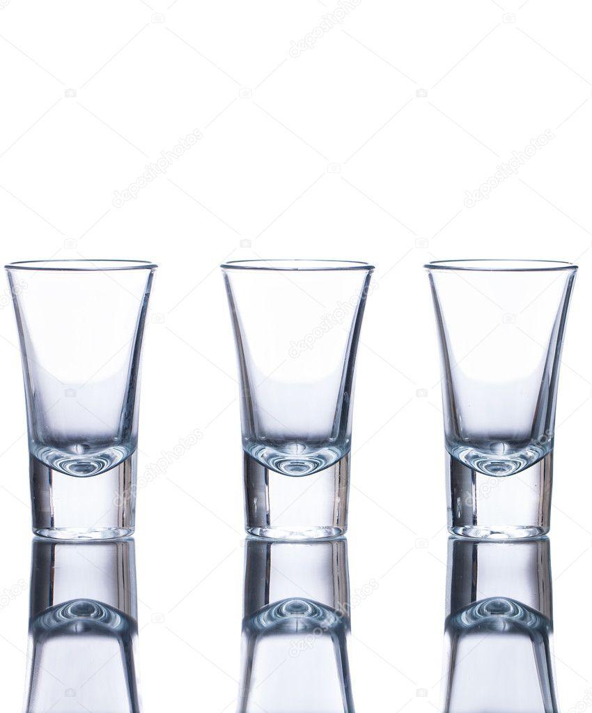 http://static9.depositphotos.com/1062921/1147/i/950/depositphotos_11478004-Three-empty-shot-glasses.jpg