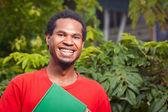 Happy dark skinned student — Stock Photo