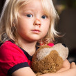 Sad injured boy with stuffed toy — Stock Photo