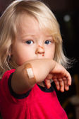 Injured boy with band aid on — Stock Photo
