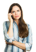 Annoyed woman on the phone — Stockfoto