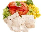 Fresh salad with chicken pieces — Stock Photo