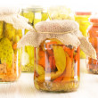 Composition with jars of pickled vegetables. Marinated food. — Photo