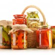 Composition with wicker basket and jars of pickled vegetables. — Stock Photo #11078850