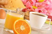 Breakfast on the table. Coffee, orange juice, rolls, muesli. — Stock Photo
