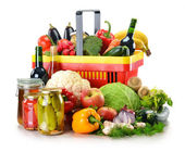 Plastic shopping basket and grocery isolated on white — Stock Photo