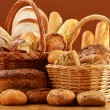 Composition with bread and rolls in wicker basket - Foto de Stock