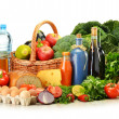 Groceries in wicker basket including vegetables and fruits — Foto de Stock