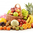 Composition with assorted fruits in wicker basket — Stock Photo #12050576