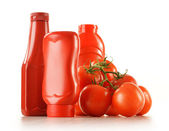 Composition with ketchup and fresh tomatoes isolated on white — Stock Photo