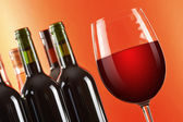 Composition with two wineglasses and bottles of red wine — Stock Photo