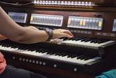 Playing piano organ — Stock Photo