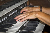 Hand playing piano — Stock Photo