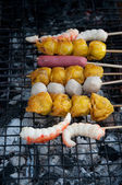 Grilling meat ball on stick — Stock Photo