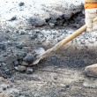 Pothole repairing works - Stock Photo