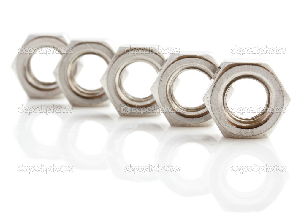 Stainless steal nuts in a row isolated over white — Stock Photo #10743099