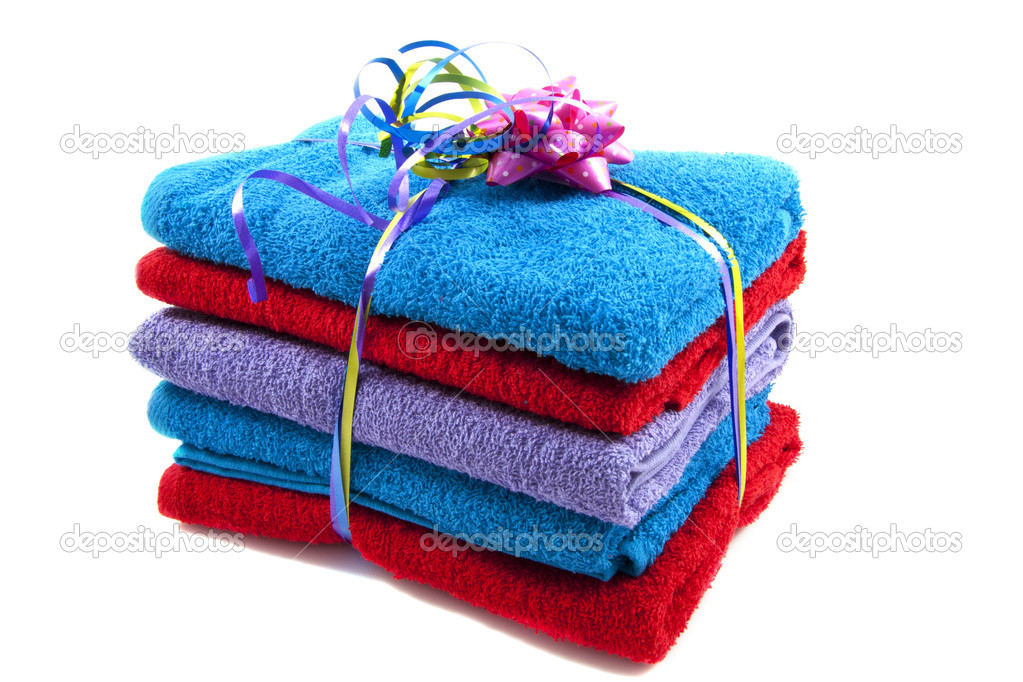 Colorful towels on a pile isolated over white — Stock Photo #11083057