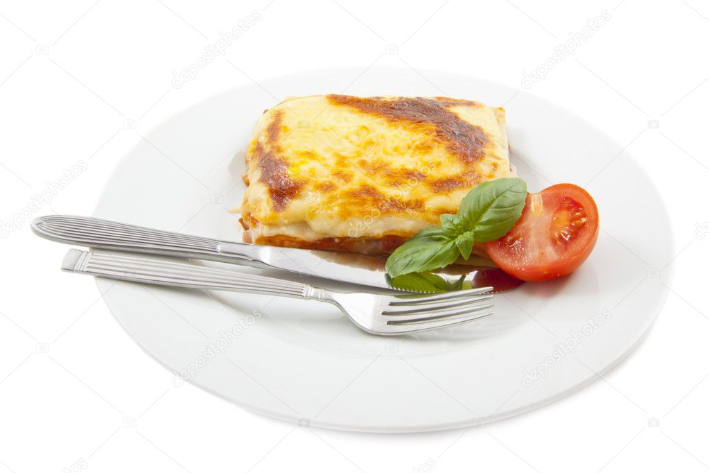 Lasanga with basil and tomato  isolated over white — Stock Photo #11427038