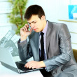 Portrait of a smart business man using laptop in modern office — Stock Photo