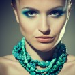 Beautiful sexy young woman with turquoise makeup and — Stock Photo