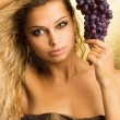 Beautiful young sexy woman with a grape — Stock Photo
