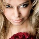 Beautiful girl holding a rose — Stock Photo #11693200