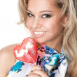 Happy young girl with a candy heart — Stock Photo #11693202