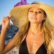 Outdoor portrait of a young beautiful sexy tanned blond woman — Stock Photo #11693210