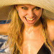 Outdoor portrait of a young beautiful sexy tanned blond woman — Stock Photo #11693218