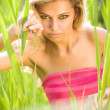 Sexy young blond woman in green grass - ストック写真