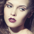 Closeup portrait of a sexy young caucasian woman with red lips — Stock Photo