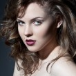 Closeup portrait of a sexy young caucasian woman with red lips - Stockfoto